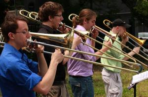 A traveling trombone quartet, TromBoston, played throughout Lynn on Saturday drawing people to downtown for a festival. Downtown Lynn's art scene is helping revitalize the area.